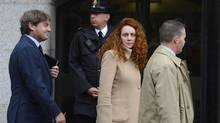 Former News International chief executive Rebekah Brooks and her husband Charlie, left, leave the Old Bailey court in London Sept. 26, 2012. Brooks and her husband are charged with conspiracy to pervert the course of justice in relation to the phone hacking scandal. (PAUL HACKETT/REUTERS)