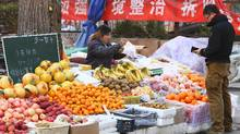 A vendor on Thursday sells fruit on a street in Beijing (Tony Frank for The Globe and Mail/Tony Frank)