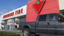 Customers arrive at the Canadian Tire store in North Vancouver, B.C. on February 10, 2011. (Andy Clark/REUTERS)