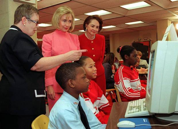 First Lady Hillary Clinton and Aline Chretien view a demonstration of SchoolNet, a digital education tool, during a tour of Burrville Elementary School in Washington, D.C. in April, 1997.