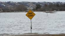 A road is closed due to high water in the Qu'Appelle Valley northwest of Regina. (Roy Antal/The Canadian Press)