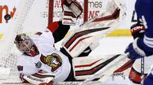 Ottawa Senators goalie Craig Anderson dives to stop a shot against the Leafs on Feb. 4, 2012. (Blair Gable/Reuters/Blair Gable/Reuters)
