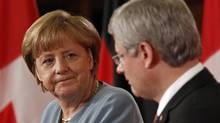 Germany's Chancellor Angela Merkel takes part in a news conference with Canada's Prime Minister Stephen Harper on Parliament Hill in Ottawa August 16, 2012. (CHRIS WATTIE/REUTERS)