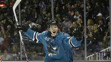 San Jose Sharks' Tomas Hertl, of the Czech Republic, celebrates his third goal of the game against the New York Rangers during the third period of an NHL hockey game on Tuesday, Oct. 8, 2013, in San Jose, Calif. (MARCIO JOSE SANCHEZ/AP)