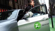 A woman demonstrates Zipcar registration process in New York. Spencer Platt/Getty Images
