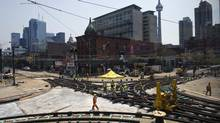 TTC crews and construction workers tear up the intersection of Queen Street West and Spadina Avenue on July 13, 2012. (Galit Rodan/The Globe and Mail)