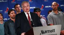 Donald Fehr, executive director of the National Hockey League Players' Association, speaks at a news conference with players behind him in New York September 13, 2012. (ERIC THAYER/REUTERS)