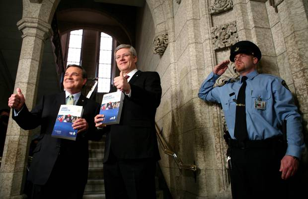 Former finance minister Jim Flaherty, left, and former prime minister Stephen Harper give a thumbs up as they walk to the House of Commons to deliver the budget on Parliament Hill in March, 2012.