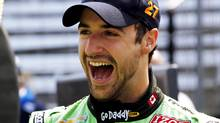 Andretti Autosport driver James Hinchcliffe of Canada laughs with his crew during practice time at the Indianapolis Motor Speedway in Indianapolis May 25, 2012. (Brent Smith/Reuters)