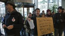 A group of protestors from the nearby Occupy Vancouver encampment demonstrate in the lobby of a downtown office tower Thursday, Nov. 17, 2011. (ANDY CLARK/REUTERS)