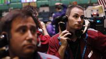 Traders work in the crude oil and natural gas options pit at the New York Mercantile Exchange. West Texas intermediate, which sets the trend for Canadian prices, is selling a steep discount to internationally traded crude, like North Sea Brent. (Shannon Stapleton/Reuters/Shannon Stapleton/Reuters)