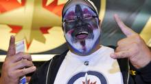 A Winnipeg Jets fan arrives at the MTS Centre for the Jets' NHL pre-season game against the Columbus Blue Jackets in Winnipeg, September 20, 2011. REUTERS/Fred Greenslade (Fred Greenslade/Reuters)