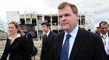 Canada's Minister of Foreign Affairs John Baird, right, and Canadian Ambassador to Libya Sandra McCardell, left, visit the former fortified compound of Moammar Gadhafi in Bab al-Azizya in Tripoli, Libya on Tuesday, October 11, 2011. (Sean Kilpatrick/The Canadian Press/Sean Kilpatrick/The Canadian Press)