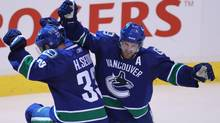 The Vancouver Canucks' Henrik Sedin celebrates his goal with Daniel Sedin during last year's playoffs. (Jonathan Hayward/The Canadian Press/Jonathan Hayward/The Canadian Press)