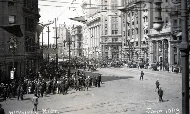 "1919: Portage and Main was a hub of protest for workers in the Winnipeg General Strike, the first such labour protest in North America. On June 10, pictured here, the protesters at Portage and Main were met with club-wielding special police officers. Eleven days later came ""Bloody Saturday,"" when protesters on Main Street overturned a streetcar, the mayor read the riot act and Mounties charged the crowd. Two workers were killed."