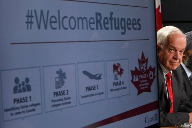 John McCallum, Minister of Immigration, Refugees and Citizenship, announces Canada's plan to resettle 25,000 Syrian refugees at a press conference at the National Press Theatre in Ottawa on Nov. 24, 2015.