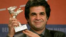 Iranian director Jafar Panahi posing with his Jury Grand Prix silver bear award for his movie Offside at the 56th Berlinale Film Festival in Berlin in 2006. (JOHANNES EISELE/AFP/Getty Images/File)