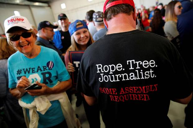 Nov. 6, 2016: After a Trump rally in Minneapolis, photos of this man's T-shirt – 'Rope. Tree. Journalist. Some assembly required' – went viral as the Republican candidate continued his invective against the news media.