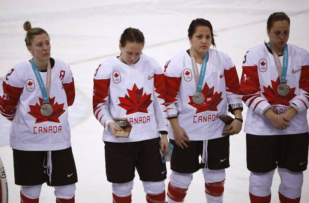 Jocelyne Larocque holds her silver medal during the medal ceremony after the women's hockey gold medal game on Feb. 22, 2018 in Pyeongchang.