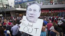 A supporter holds a photo cutout of Los Angeles Clippers owner Donald Sterling while standing in line for the NBA Playoff game 5 between Golden State Warriors and Los Angeles Clippers at Staples Center in Los Angeles, California. (Mario Anzuoni/REUTERS)