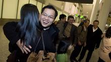 Vincent Nguyen, who will become Canada's youngest Catholic bishop and the first of Asian descent, greets four of his nine siblings arriving from Vietnam on Jan. 11, 2010. This is the first time in 30 years that all nine siblings have been reunited. (Peter Power)