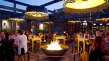 El Catrin's massive cobblestone patio is breathtaking and warmed by a fire from an enormous steel bowls. (Peter Power/The Globe and Mail)