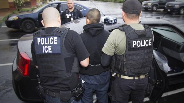 In this photo taken Feb. 7, 2017, an arrest is made during a targeted enforcement operation conducted by U.S. Immigration and Customs Enforcement (ICE).