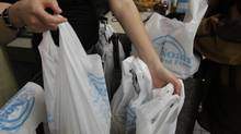 Plastic bags, including biodegradable ones like from Noah's Natural Foods, will be banned from Toronto vendors starting in 2013. (Fernando Morales/The Globe and Mail)