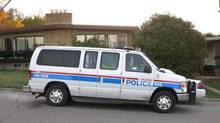 A Calgary Police van sits on Saturday, Sept. 28, 2013, in front of a home that a Freemen-on-the-Land follower had claimed as an embassy. (Bill Graveland/THE CANADIAN PRESS)