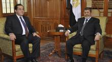 Egyptian President Mohamed Mursi (R) meets with opposition figure Ayman Nour (L), chairman of el-Ghad political party, in Cairo February 16, 2013. (Handout/Reuters)