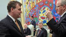 John Baird is sworn-in as Minister of Foreign Affairs as Prime Minister Stephen Harper and Governor-General David Johnston look on at Rideau Hall on May 18, 2011. (CHRIS WATTIE/Reuters)