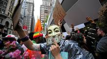 Occupy Wall Street members stage a protest march near Wall Street in New York, on October 12, 2011. (EMMANUEL DUNAND/EMMANUEL DUNAND/AFP/Getty Images)