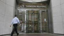 A worker enters the Thomson Reuters building in the Canary Wharf financial district of London on Aug. 6, 2009. (SIMON NEWMAN/Reuters/SIMON NEWMAN/Reuters)