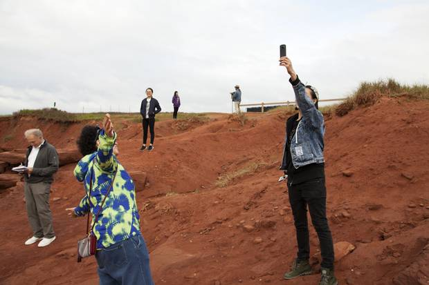 Cavendish, PEI: Ian Brown, left, takes notes as the travellers enjoy the red sandy vistas of Cavendish Beach.