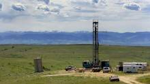 A coal-bed methane drilling rig in Wyoming. Water containing compounds such as sodium bicarbonate is often extracted from the ground as companies produce oil and gas. (Jordan Edgcomb/AP)