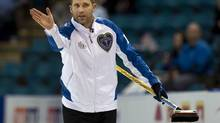 British Columbia skip John Morris gestures as they play New Brunswick at the Tim Hortons Brier in Kamloops, B.C. on Tuesday, March 4, 2014. (Andrew Vaughan/THE CANADIAN PRESS)