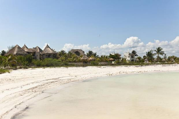 The island of Holbox in Mexico is walkable, and the ocean is calm enough for children to swim safely.