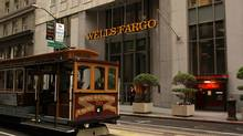 A cable car passes the Wells Fargo Bank headquarters in the Financial District in San Francisco, California March 28, 2012. (ROBERT GALBRAITH/REUTERS)