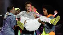 Justin Bieber performs at a free open-air concert at Zocalo Square in Mexico City June 11, 2012. (HENRY ROMERO/Reuters)