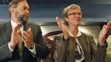 Deputy leader Thomas Mulcair and Interim Leader Nycole Turmel applaud during the NDP's summer caucus retreat in Quebec City on Sept. 14, 2011. (MATHIEU BELANGER/REUTERS)