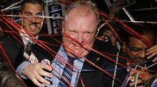 Mayor-elect Rob Ford is greeted by his supporters at the Toronto Congress Centre in Toronto after winning the election. (Peter Power/Peter Power/The Globe and Mail)