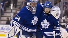 Toronto Maple Leafs goaltender James Reimer (left) is helped off the ice by John-Michael Liles during second period NHL action against Philadelphia Flyers in Toronto on Monday February 11, 2013. (Chris Young/THE CANADIAN PRESS)