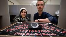 UBC Cognitive Systems student Mahtab Borhani, left, and Simon Garret are photographed with a Ouija board being used in an experiment to explore how the boards can be used to unlock subconscious memories. (DARRYL DYCK for THE GLOBE AND MAIL)