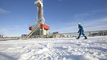 A Nexen worker walks past a shale-gas drilling rig in the Etsho area of northeastern B.C. (Dave Olecko/Nexen)