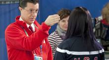 U.S. comedian Stephen Colbert speaks with speed skater Lauren Cholewinksi during the women's 500-metre event at the Olympic Oval in Richmond, B.C., on Wednesday, Feb. 17, 2010. (Adrian Wyld)