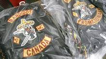 Bandidos biker gang jackets are displayed at a joint OPP and Winnipeg Police news conference on June 16, 2006. (John Woods)