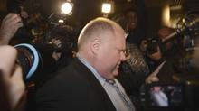 Toronto Mayor Rob Ford squeezes past the media throng as he heads for the elevators to council chambers on Nov. 13, 2013. (FRED LUM/THE GLOBE AND MAIL)