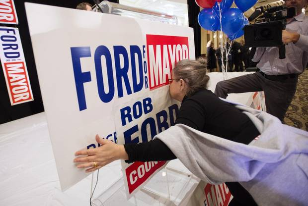 Gail Chernesky kisses a sign at Doug Ford's election night headquarters in 2014.