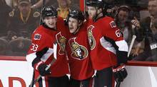 Ottawa Senators' Kyle Turris celebrates his goal against the Boston Bruins with teammates Jakob Silfverberg and Eric Gryba during the first period of their NHL hockey game in Ottawa March 11, 2013. (CHRIS WATTIE/REUTERS)