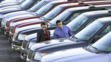 Couple car shopping (Ron Chapple/Thinkstock)